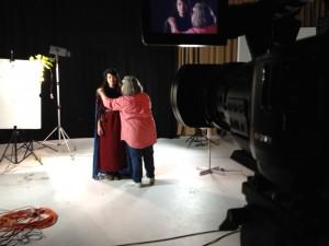 Posie adjusts wardrobe of Ella as Signy